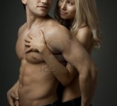 14996143-muscular-handsome-sexy-guy-with-pretty-woman-on-dark-background-glamour-light