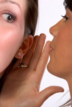 woman-whispering-to-woman