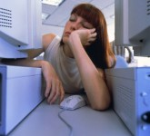 Woman sleepings in an open-plan office