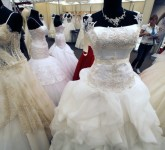 A woman looks at bridal gowns during the E-Marriage Fest wedding fair in Bucharest