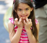 Suri Cruise makes cute faces at the paparazzi at the Central Park Children's Zoo in NYC