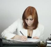 stock-footage-business-woman-fills-the-document-and-submit-for-signature