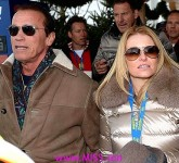 ARNOLD SCHWARZENEGGER and new girlfriend HEATHER MILLIGAN surrounded by security