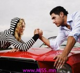 Couple Arm Wrestling on Car Hood