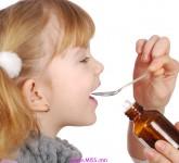girl taking medicine