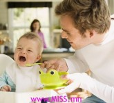photolibrary_rf_photo_of_father_feeding_crying_baby