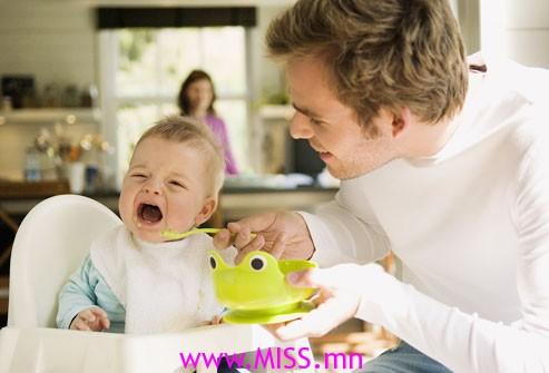 photolibrary_rf_photo_of_father_feeding_crying_baby