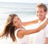 Happy-couple-on-beach-in-love-1