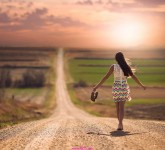 Lonely Girl Walking On Road Wallpaper