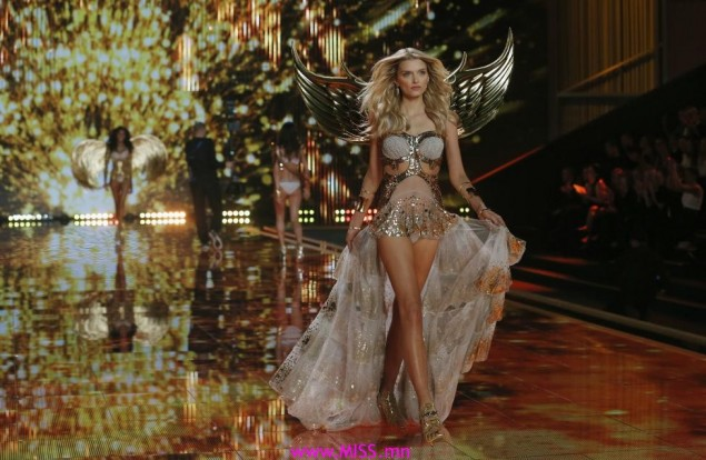A model presents a creation at the 2014 Victoria's Secret Fashion Show in London