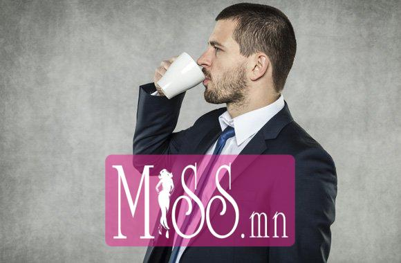 man-in-suit-drinking-coffee