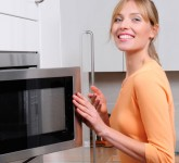 woman-cleaning-a-microwave