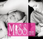 New mother holds her newborn infant in this precious baby picture by Charlotte photographer.
